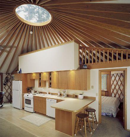 Yurt with kitchen peninsula and loft.