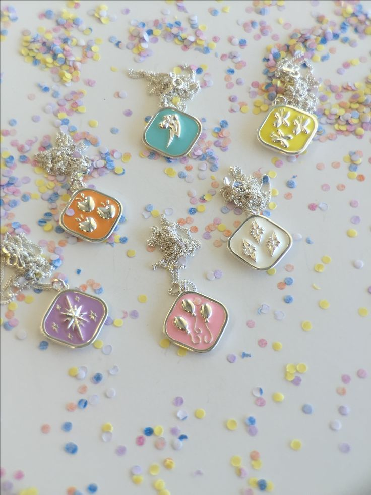 Inspired by My little pony. These Sterling silver pendants have been filled with coloured enamel and reflect the cutie marks of the Ponies.