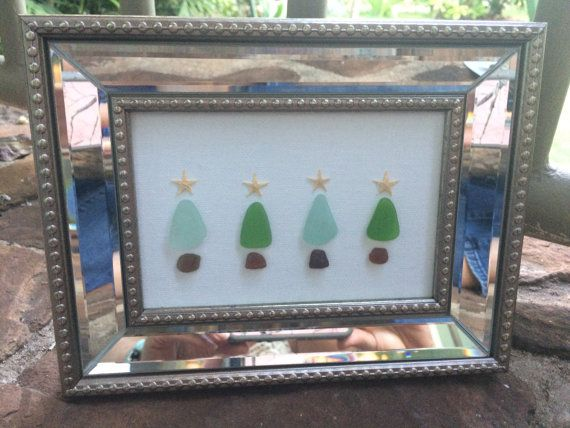 Stunning framed artwork of Hawaiian Sea Glass Christmas Trees is the perfect addition to your beachy Christmas decor! Sea glass pieces and tiny starfish make for a cute, beachy holiday scene on a 4X6 canvas framed to sit or hang as the focal point of your decorations. Bring some aloha to your holidays