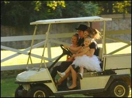 September 26, 2013 - Lisa Marie Presley and husband Michael Lockwood, with their twin daughters; Harper and Finley enjoyed a golf-cart ride at Graceland!