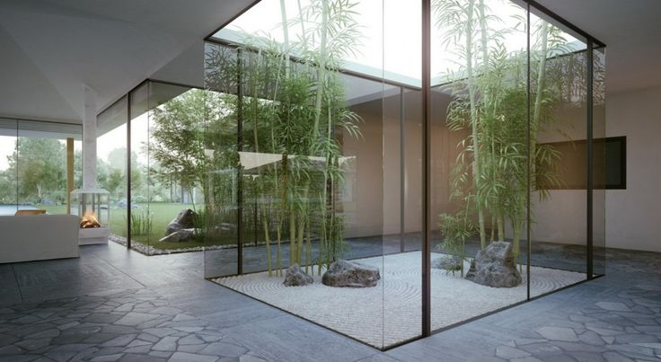 Exterior. Modern Courtyard Design Alongside Green Bamboos Trees And Patterned Coral Ground With Natural Stone Setting Include Glass Room Partitions Combined With Natural Stone Floor Material Also Beige Colored Wall.