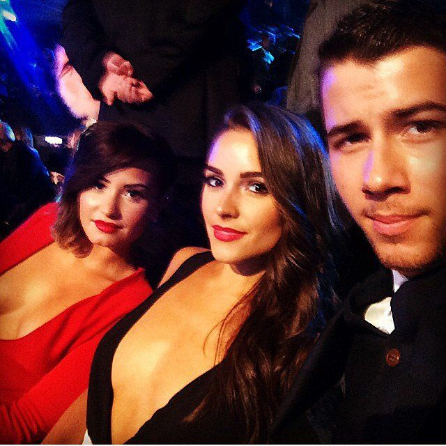 Pin for Later: Go Behind the Scenes With the Stars at the MTV VMAs!  Cute couple Nick Jonas and Olivia Culpo got a picture with Demi Lovato.