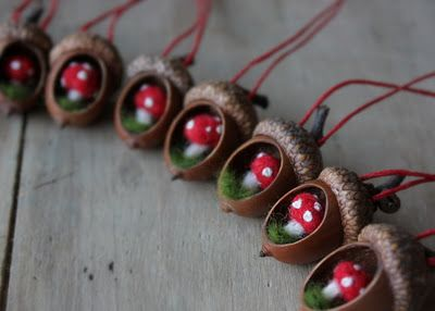 acorn ornaments. I bet you could just use the belt sander to make that nice smooth hole in the acorn and then just pick out the nut. Then Sculpey or felt mushrooms. Awesome.