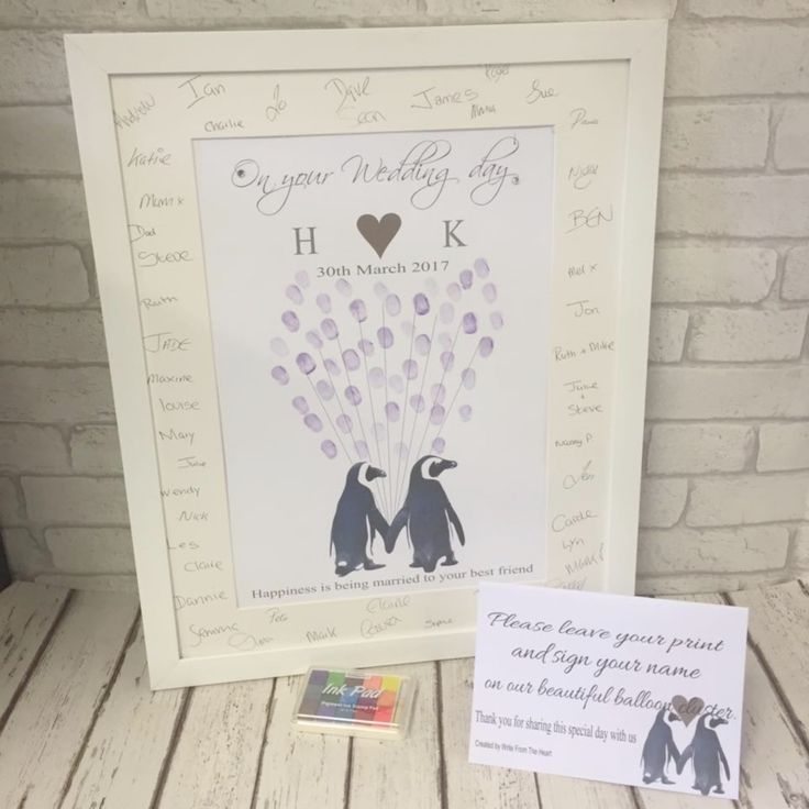 Wedding penguins fingerprint balloon cluster Text reads ; On your wedding day (Any ititials & date) Text at bottom ; Happiness is being married to your best friend   PACKAGE INCLUDES- A PERSONALISED DESIGN MOUNTED IN A DELUXE CARD MOUNT WITH BACKING BOARD AVAILABLE WITH OR WITHOUT FRAME, MULTI COLOR INK PAD & INSTRUCTION CARD. Diamantes and 3d hearts are added by hand to the finished design to make it even more special!