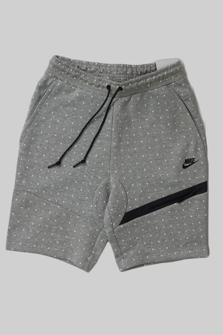 The Nike Tech Fleece Dot Men's Shorts offer convenient storage and a bold look with a bonded zip pocket and an allover print on soft, insulating fabric. - Product Code: 642964-063 - Color: Dark Grey H