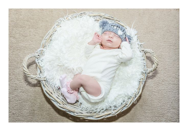 Newborn photography with basket prop.