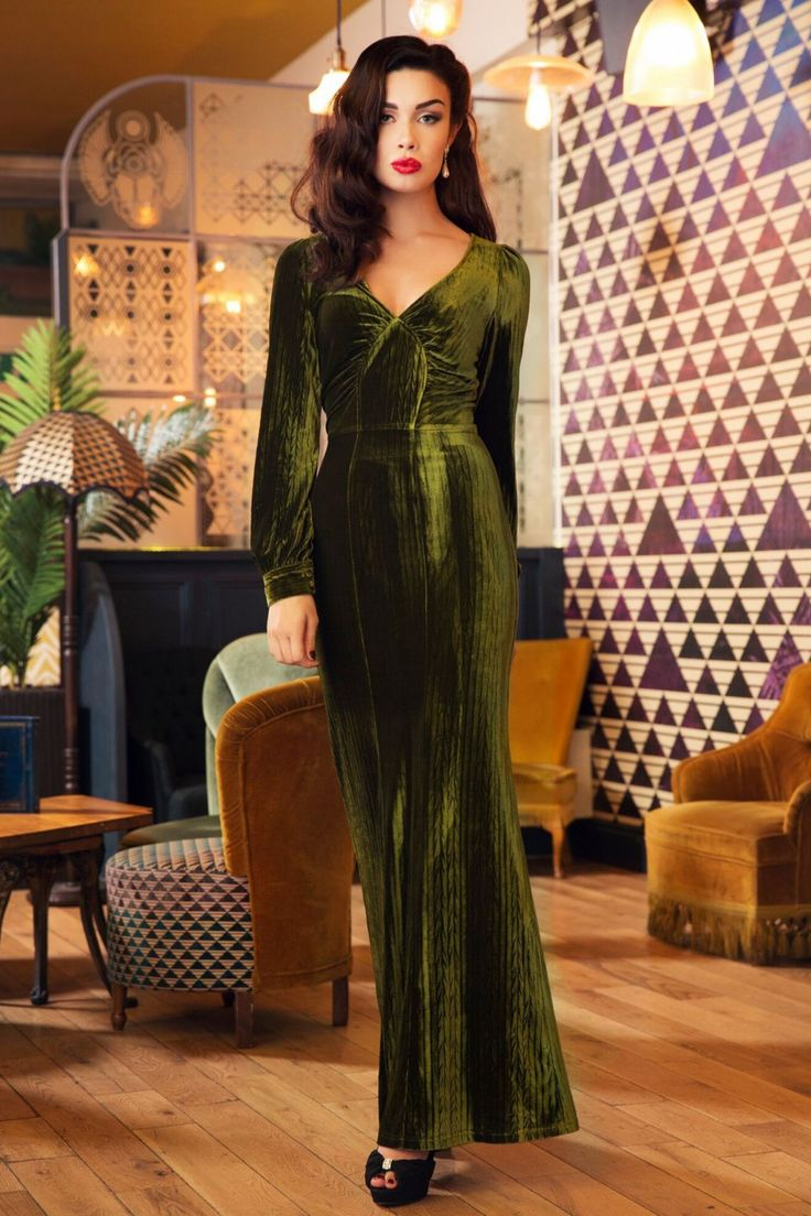 This 30s Olivia Velvet Maxi Dress is velvet glamour to the max!  You surely will make an entrance when wearing this maxi! Super elegant V-neckline, gathered bust, long bishop sleeves with cuffs and a classy, sleek full length skirt just like the dresses from the thirties.Made from a super soft, olive green, velvet fabric featuring a subtle cable pattern and a lovely stretch. Whether it's the light of the flashing camera's or from theflickering candles, it gives the vel...