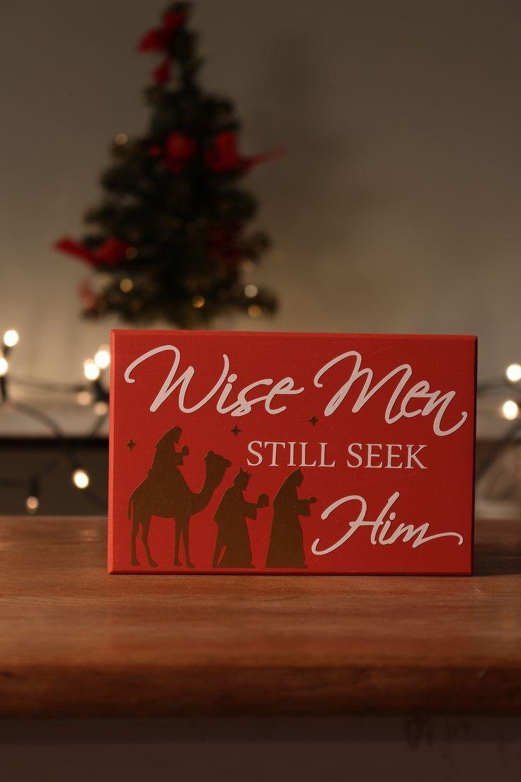 """This wooden block is a poignant reminder of life's greatest journey. With white lettering and golden silhouettes of the wise men and stars, it is the perfect compliment for a nativity scene. """"Wise Men Still Seek Him"""""""