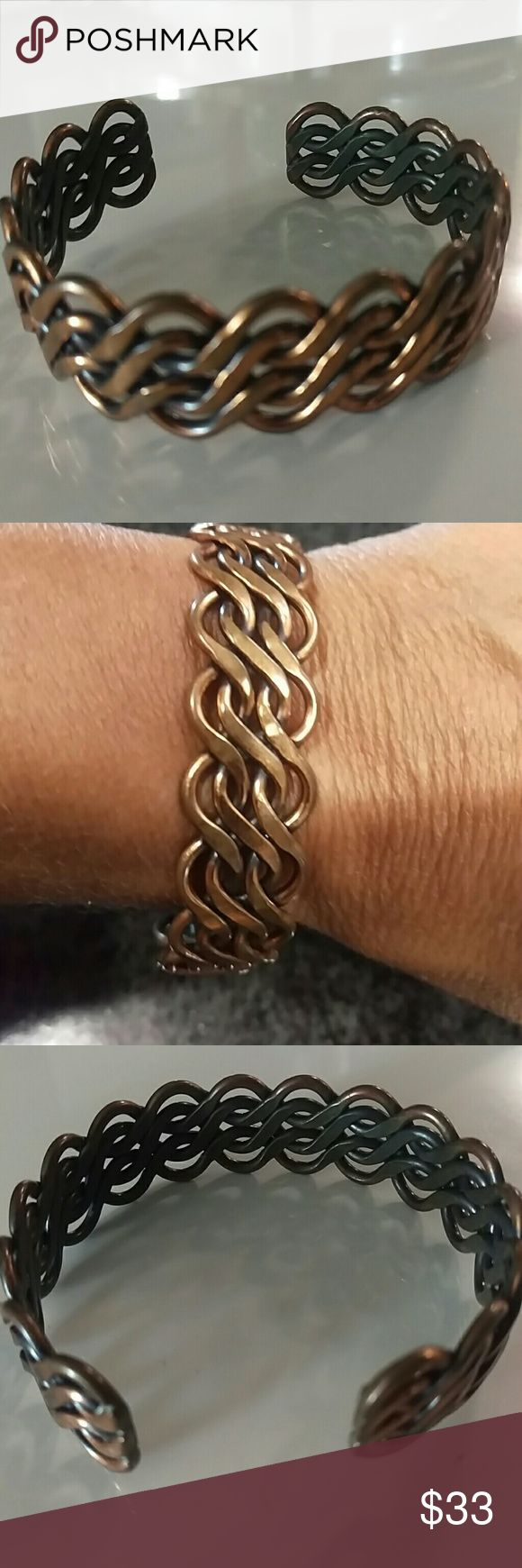 Copper bracelet, one size 10% discount if you add to a bundle! Cute Copper bracelet intricately woven into a wavy design. Squeeze closure, this is a sturdy metal not soft. The outside is a copper color the inside is more of a brass. This is a vintage piece but in very good condition.  Please inspect photos closely Jewelry Bracelets