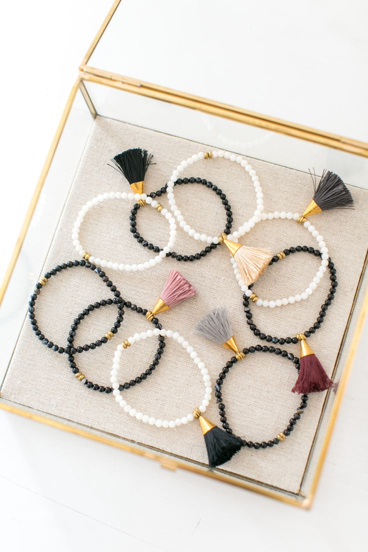 Stack these chic beaded bracelets for a stylish look. This handmade bracelet features a fun tassel that adds charm to your outfit.