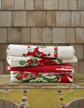 Christmas vintage tablecloths... I have one just like this, that belonged to my Mom. Have been using it as a tree skirt.