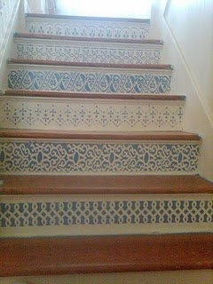 Stair facing I painted. I found patterns I liked online and made my own stencils to save money.  Can't really say I remained sane during this whole process! :)
