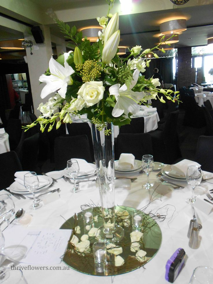 Stunning Elegant Arrangement Of White Roses Lilies Orchids And Greenery A