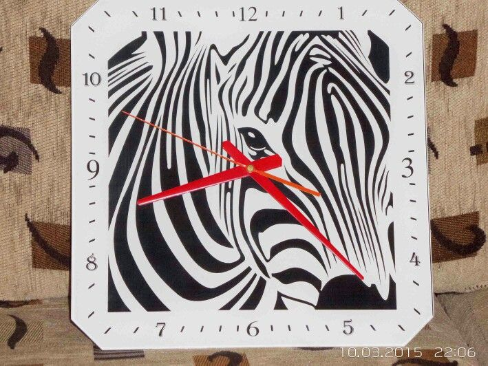 Wall clock made of 5 mm thick, classic white, Lacobel glass. Size 33 cm by 33 cm.
