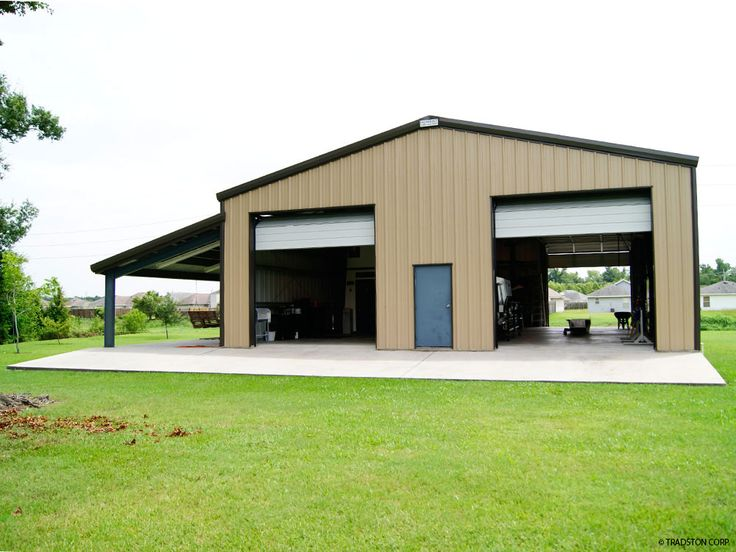 Steel garage building with two high overhead doors and a lean-to on the side.
