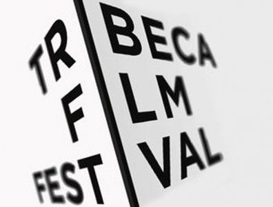 """New York, city streets, skyscrapers, street signs, moving film through a projector... And then there's the """"I"""" that takes it to the next level. Tribeca Film Festival logo"""