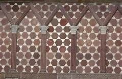 The patterns that became prominent on renaissance furniture reflected an insular culture and were typically based on geometrical shapes, such as the design seen at the medieval structure, the Lorsch Gate.