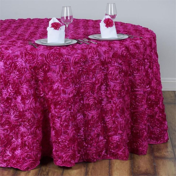 """132"""" Fushia Wholesale Grandiose Rosette 3D Satin Round Tablecloth For Wedding Party Event /  Add oodles of flair and character in your party with our enticing raised rosette tablecloth, which is simply breathtaking. The very sight of this floral ecstasy will bring the divine vision of a paradise garden with its whimsical blossoms and luster into your event/celebration. For those special and rare celebrations that need to have an extra doting touch in their ambiance decoration, this top-notch…"""
