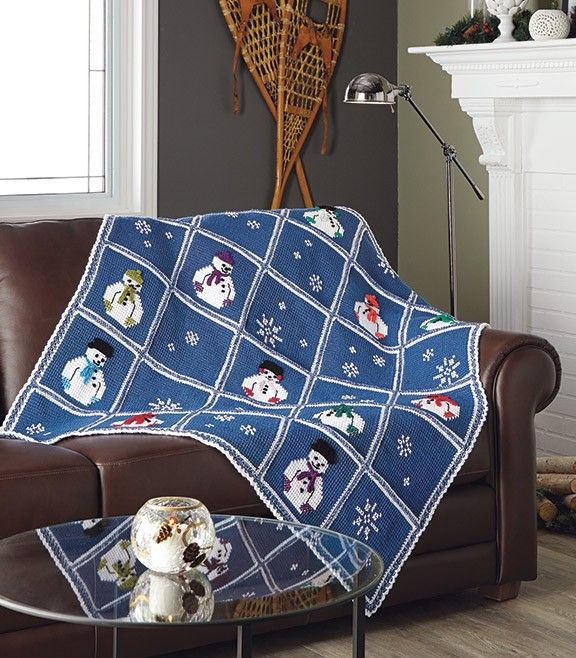 Designed by Dorothy Warrell. A fun and cozy throw to cuddle under. This is crocheted in afghan stitch and embellished with cross stitch snowmen. Includes Mary Maxim Starlette yarn and Lion Brand Bon Bons.
