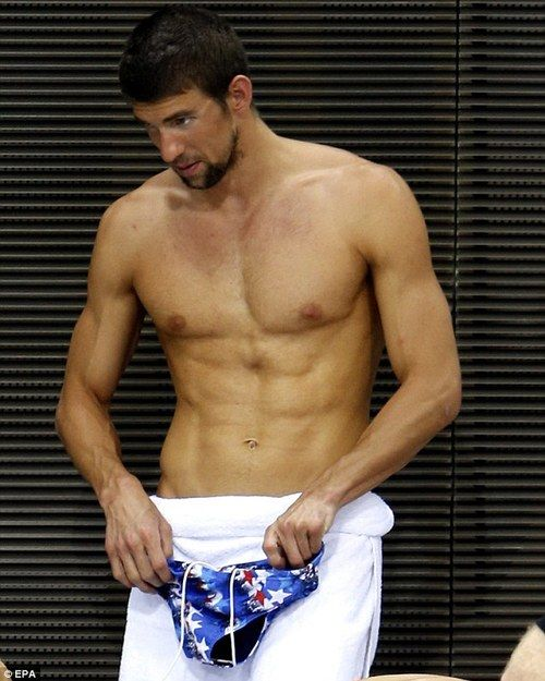 "Michael Phelps - this cracks me up. His face looks like ""you really expect me to wear this thing..?"" hahaha"