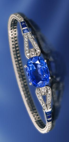 An art deco sapphire and diamond bracelet, Cartier, French, circa 1925 centering a cushion-cut sapphire, joining a slender looped line of old European and single-cut diamonds, accentuated by calibré-cut sapphires; signed Cartier Paris London New York