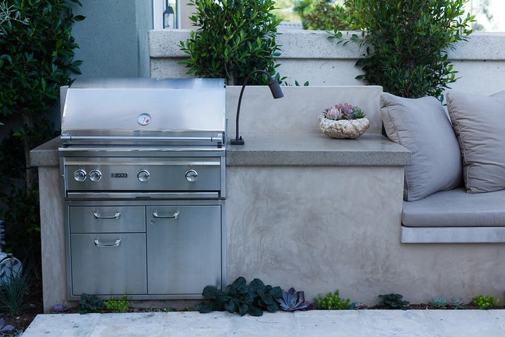 BBQ with a Smooth Stucco Face and Polished Concrete Countertop - part of wrap around bech from kitchen