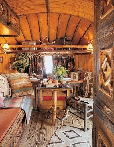 interior of gypsy caravan..how beautiful would it be to camp in this??