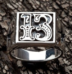 Number 13 Sterling Silver Biker Ring. Number 13 carving on the ring face with star design on the sides.