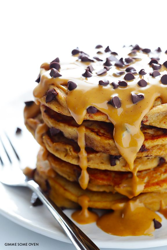 This whole wheat peanut butter chocolate chip pancakes recipe is decadent, rich, and made healthier with a few simple tweaks!