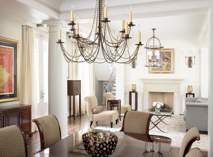 Parisian Chic A Glamorous Dining Room With A Beautiful Chandelier.