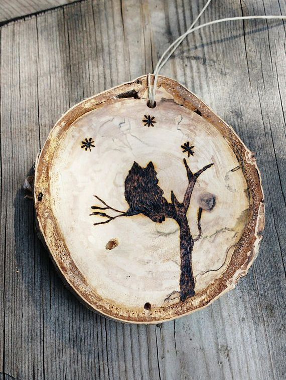 Wood burned wildlife ornaments created from reclaimed birch slices. These ornaments come from a love for the wild animals that are a part of the earth. A howling wolf, an owl perched on a branch and a deer standing in a meadow can be chosen. This is for one ornament, not a set.