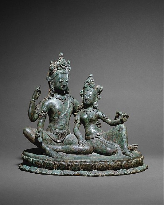 Shiva Seated with Uma (Umamaheshvara), 11th century. Thakuri dynasty. Nepal (Kathmandu Valley). The Metropolitan Museum of Art, New York. Samuel Eilenberg Collection, Ex Coll.: Columbia University, Purchase, Rogers Fund, 1987 (1987.218.1) | Shiva (Maheshvara) is shown together with his wife Uma (Parvati) in an image of great tenderness and grace, seated in royal ease on an elliptical lotus platform.