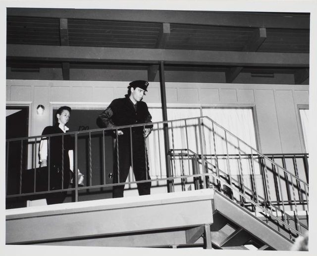 September 4th 1962, Elvis leaving the Columbia Inn Motel, Kalama, WA, about 140 miles south of Seattle. After sleeping through the day, Elvis and his crew continued the drive northward, finally arriving at the New Washington Hotel at about 1 a.m. Even at that hour, about 300 teenagers were there to greet him,ready for the commencement of filming at Century 21 or the more well known name 'The Seattle World's Fair' the next morning. Elvis was accompanied by his entourage.