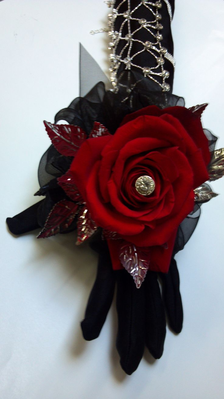 A jeweled wrist band gives a dramatic look on a black glove with a red rose.  This #corsage can used for #prom or any other event you may attend.