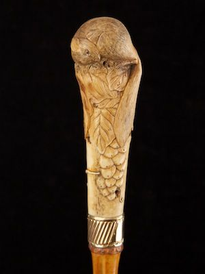 stag antler handle modelled finely as a rodent on top of a fruit bush Chinese…