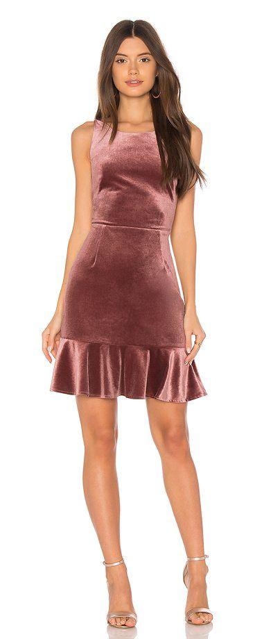 Tiffany Dress by Rebecca Minkoff. Self: 94% poly 6% elastaneLining: 100% poly. Dry clean only. Unlined. Velvet fabric. Hidden side zipper closure. Ruffled hem. RMIN-WD89. DRM6005. Classic, stylish, and functional; it's easy to see why we love Rebecca Minkoff. #rebeccaminkoff #dresses