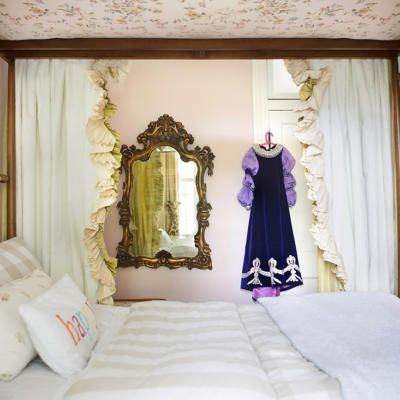 A family breathes new life into a historic King William home with their eclectic style; Canopy bed with pink fabric; Photography by Wynn Myers