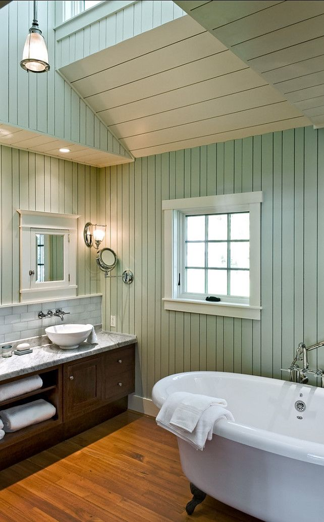 a charming cottage bathroom features a complex multivault ceiling claw foot tub and painted wooden beadboard walls via whitten i simply