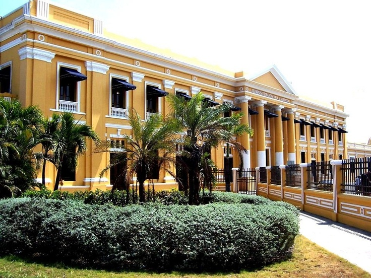 This former Palladian style customs building, is now a modern Cultural Center, formed by Piloto del Caribe Library, The Department of Atlantico Historical Archives, The Hans F. Newman Musical Documentation Center, The Mario Santo Domingo Auditorium and La Aduana Art Gallery.  It was designed and built by the English architect Leslie Arbouin in 1919, Barranquilla, Colombia