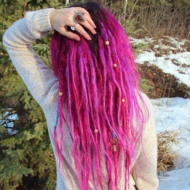 Pink dyed dreads. Color hair. Beads colour.