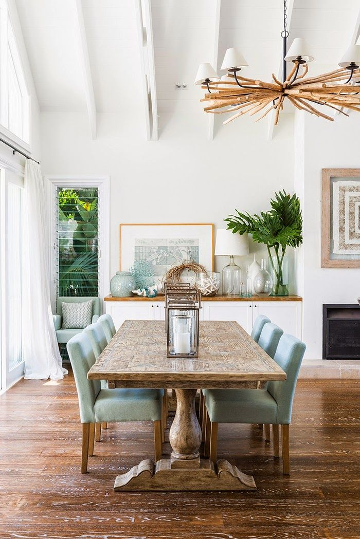 Low Backed Upholstered Dining Chairs In Duck Egg Blue, Chunky Dining Table  And Masterly Tree Branch Chandelier Make An Informal Dining Space.