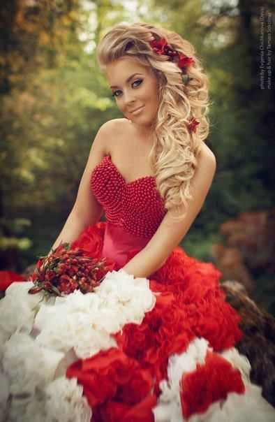 Big, curly side ponytail with red flowers.