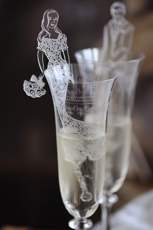 tailor-made perspex drink stirs with your wedding illustration (available at www.AstridMuellerExclusive.com - a unique conversation starter and guest favor