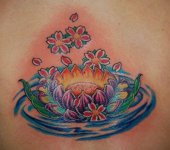 Lotus flower tattoo in blue water