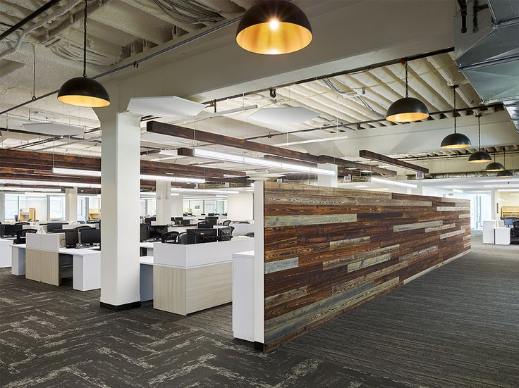 Great modern workstation design with a wood feature wall that we designed for DFC Global Corp.