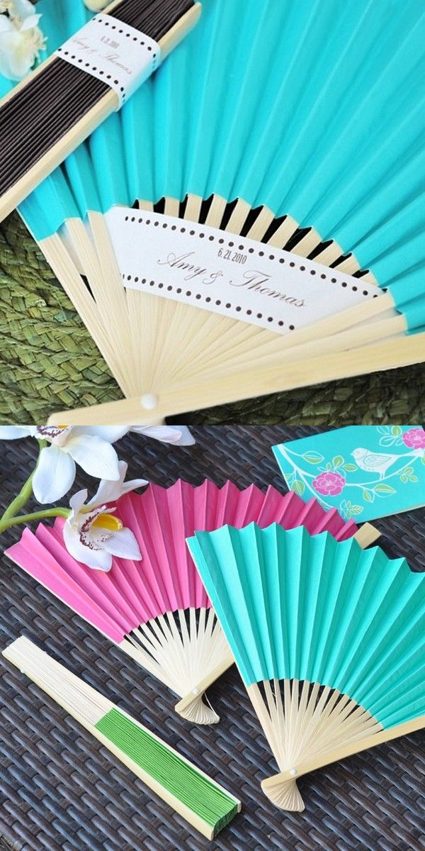 Add color, dimension and function to your summer wedding reception tables with folding hand fans as wedding favors. Use a fan paper color or several different color fans to open and place at each table setting. Print the bride and groom's names and wedding date or a wedding thank you message on decorative paper strips using your home printer. weave the paper strips in the fan spokes to create a budget-friendly DIY table decorations that doubles as a thank you favor.