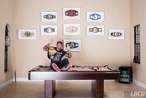 Tyrone Spong - WFCA Cruiserweight Muay Thai champion w/ his 10 belts and his Penthouse T-shirt by Philipp Plein!