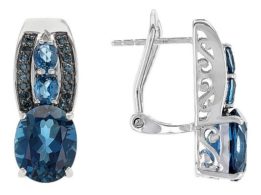6.41ctw Oval London Blue Topaz With .13ctw Round Blue Diamond Sterling