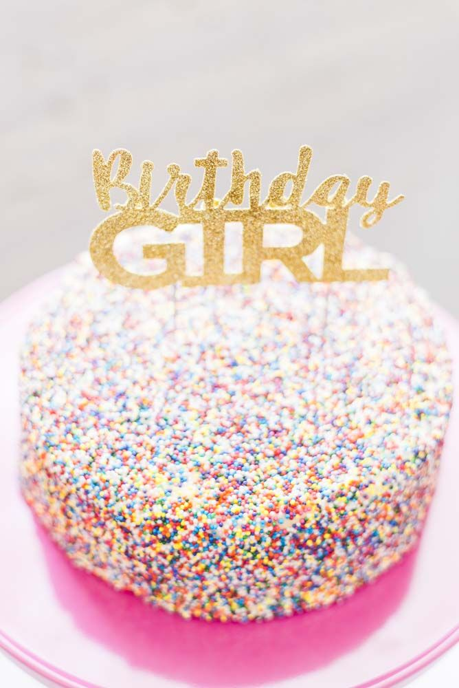 Gold glittery cake toppers among sprinkle fun (on the perfect cake plate)