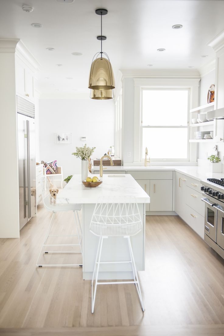 white and gray kitchen with gold accents   Photography: Julia Sperling